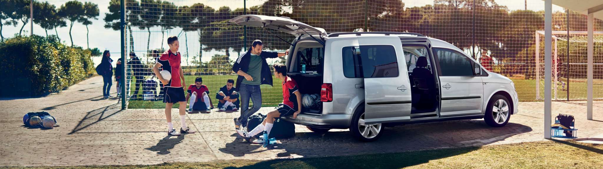 VW Caddy Trendline and Alltrack sports team vehicle image